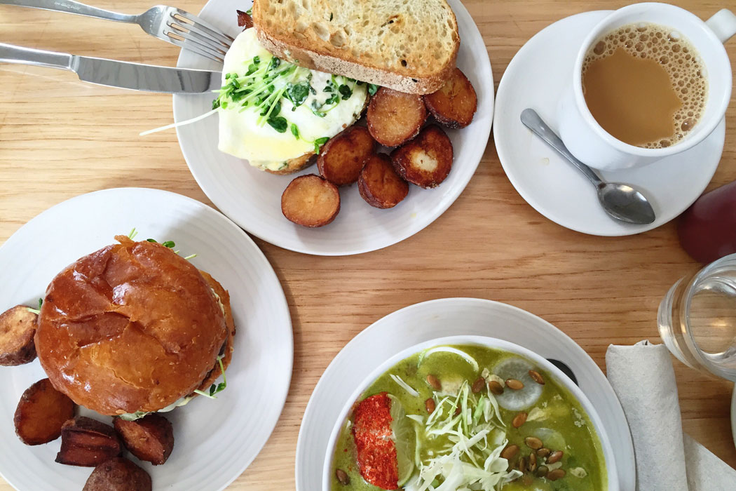 Coffee, green pozole, roasted potatoes, egg and avocado toast, and a burger at The Winchester in Ukranian Village.